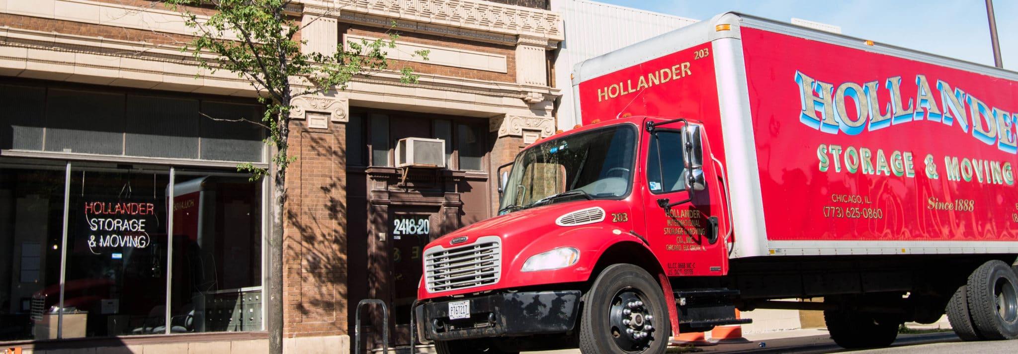 Hollander truck in front of the Hollander building