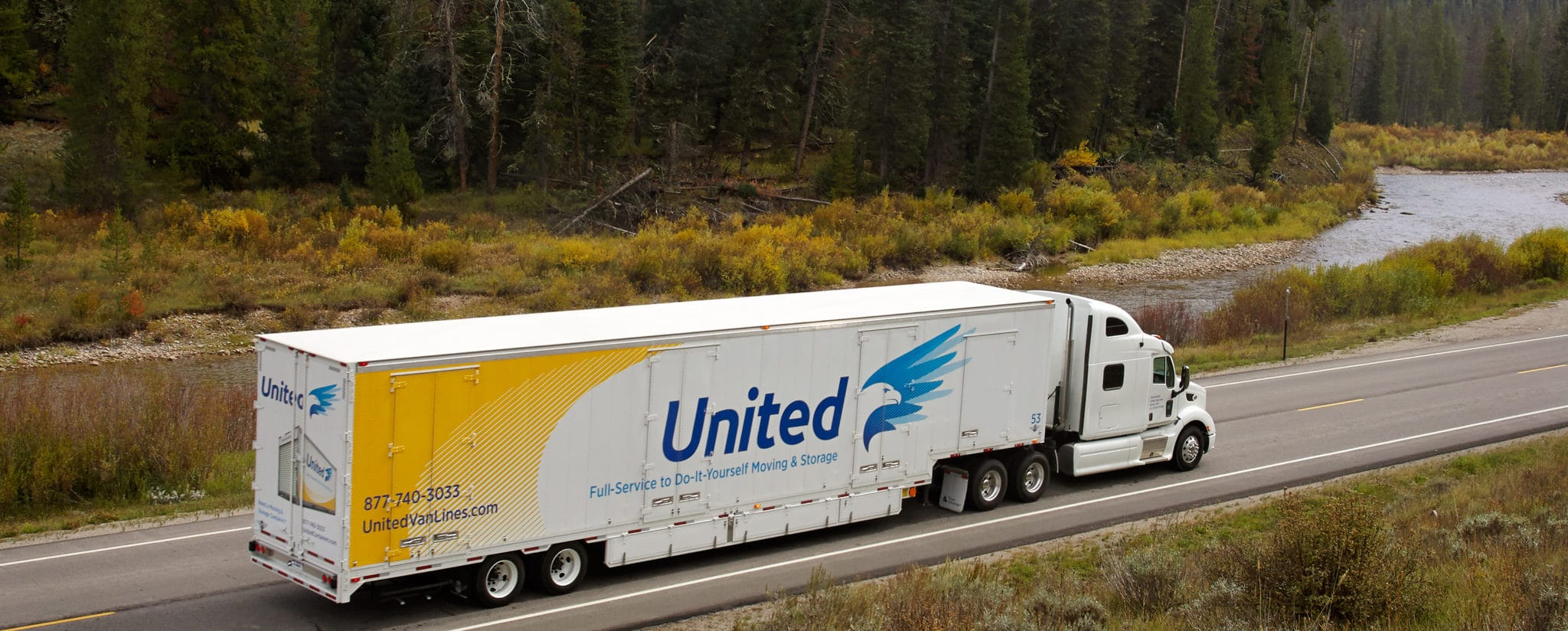 United Van driving alongside a river