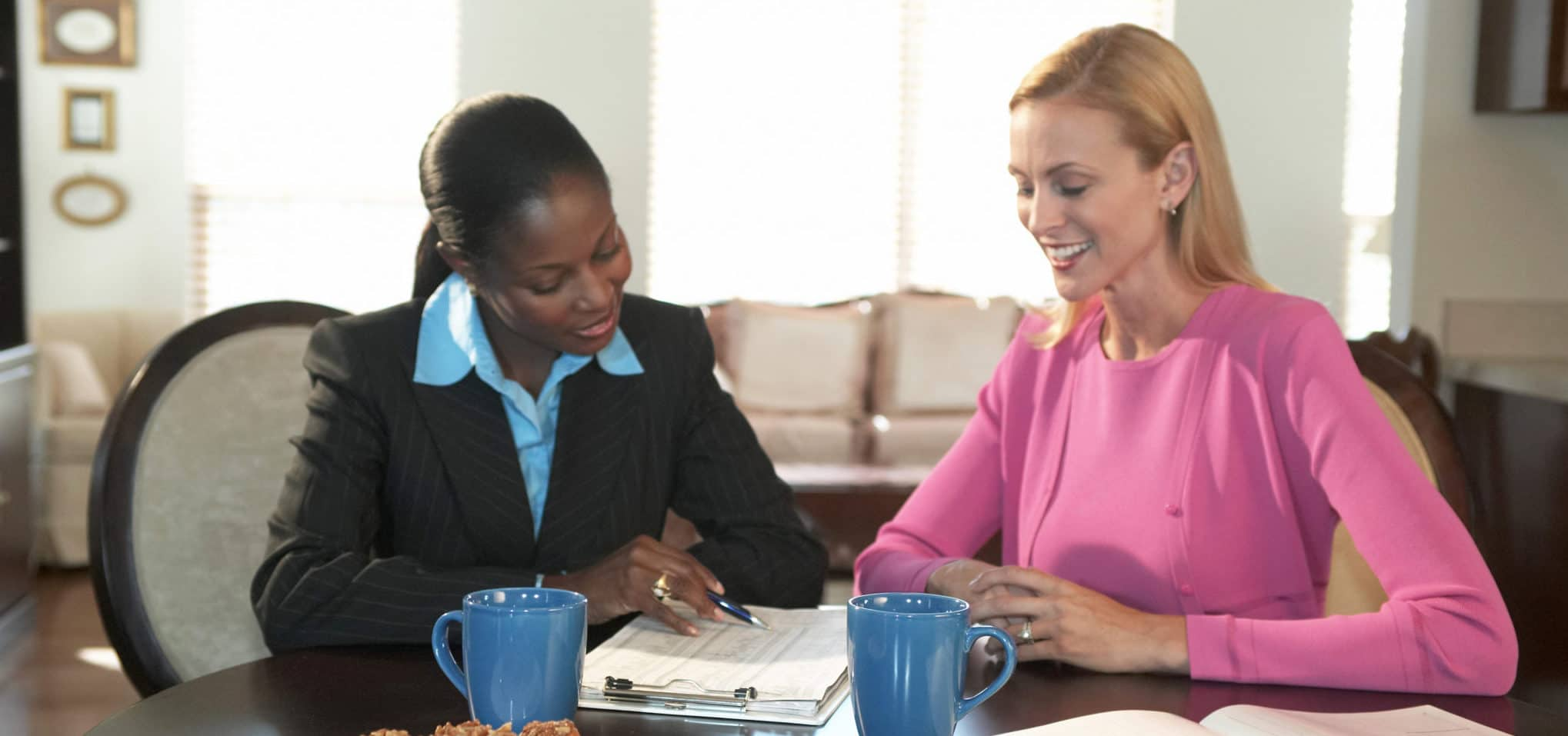 Two women going over a worksheet