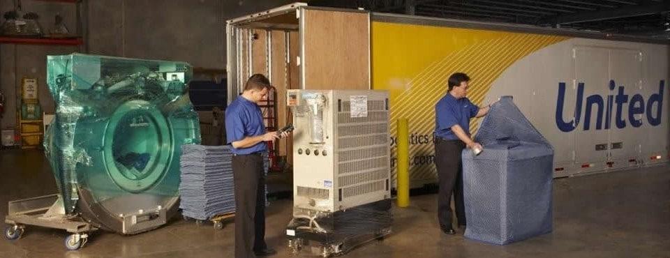 United Van with 2 men and industrial equipment