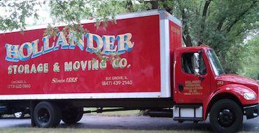 Hollander truck parked under a tree